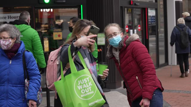 members of the public take a selfie outside the amazon fresh store on march 4, 2021 in the ealing area of london, england. shoppers at the amazon... - photography themes stock videos & royalty-free footage