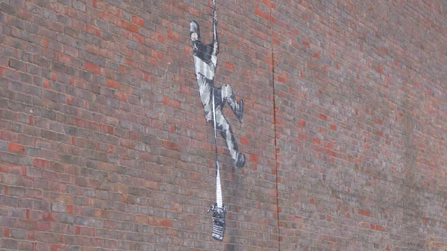 members of the public take pictures of art work by graffiti artist banksy on the side of hmp reading depicting a prisoner escaping with a typewriter,... - art stock videos & royalty-free footage