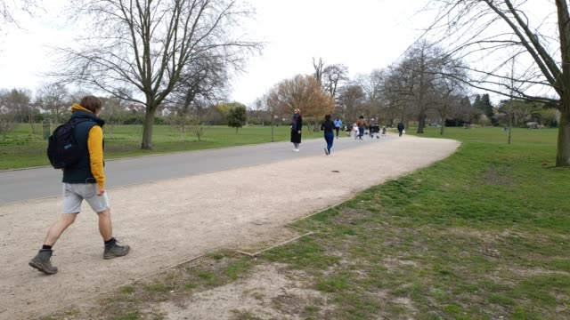 members of the public use social distancing in dulwich park during the coronavirus pandemic on april 1 2020 in london england - brian dayle coronavirus stock videos & royalty-free footage