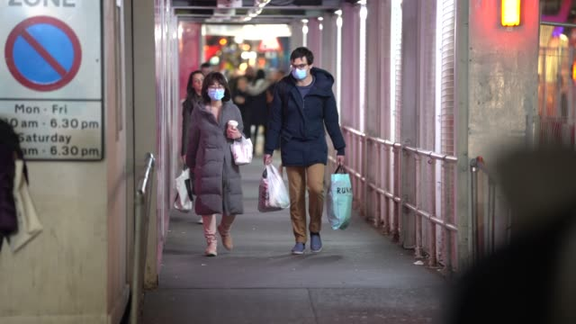 members of the public wear surgical masks as they walk around london during the coronavirus pandemic on march 17, 2020 in london, england. - medical supplies stock videos & royalty-free footage