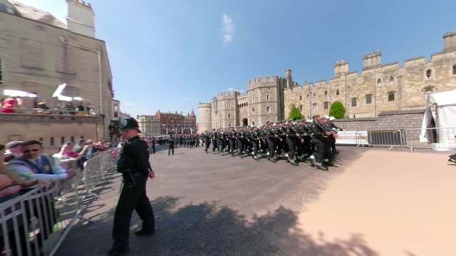 members of the queen's guard march at of the wedding of prince harry to ms meghan markle st george's chapel windsor castle on may 19 2018 in windsor... - carriage stock videos & royalty-free footage