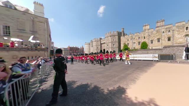 members of the queen's guard march at of the wedding of prince harry to ms meghan markle st george's chapel windsor castle on may 19 2018 in windsor... - ming stock videos & royalty-free footage