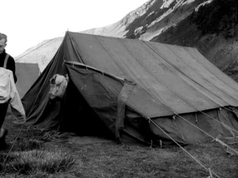 members of the raf mountain rescue team leave their tents and head off to the mountains of snowdonia during a training exercise - snowdonia video stock e b–roll