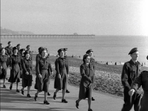 members of the royal auxiliary air force march along the seafront of a town - air force stock videos & royalty-free footage