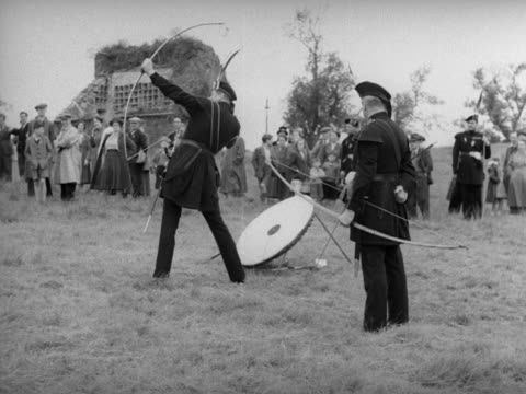 Members of the Royal Company of Archers take part in a historical contest to win a silver arrow