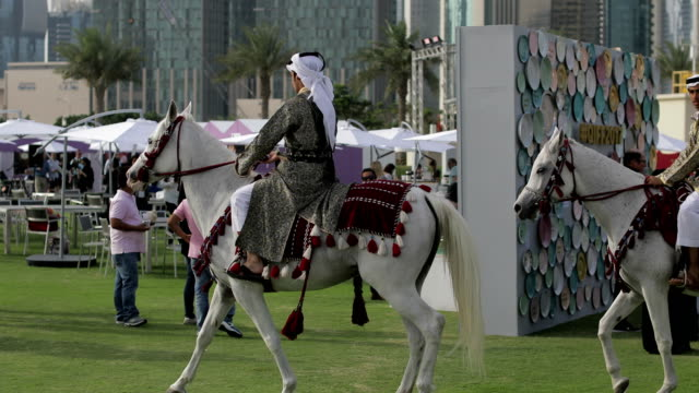 members of the royal guard in their traditional costumes on their horses during the celebrations of the qatar food festival in doha 4k resolution - event stock videos & royalty-free footage