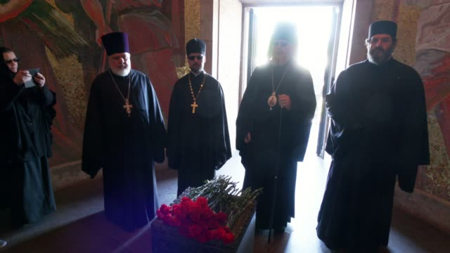 members of the russian orthodox church pray in the memorial crypt during a wreath-laying ceremony organized by the russian embassy at the soviet... - crypt stock videos & royalty-free footage