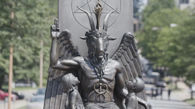 members of the satanic temple are trying to install a statue of baphomet in protest of religious freedom on the capitol's lawn - devil stock videos & royalty-free footage