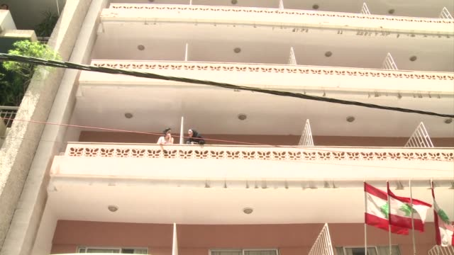 members of the security forces raided two hotels in central beirut friday and detained at least 15 people according to an afp photographer at the... - report stock videos & royalty-free footage