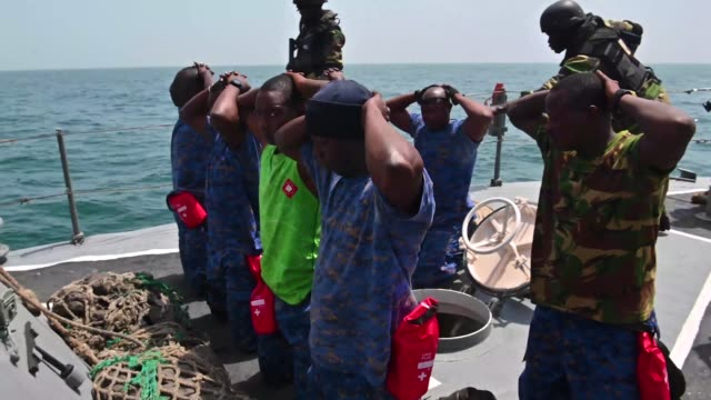 members of the senegalese and gambian navy conduct clearing techniques during a simulated drug smuggling and human trafficking scenario aboard the... - human trafficking stock videos & royalty-free footage