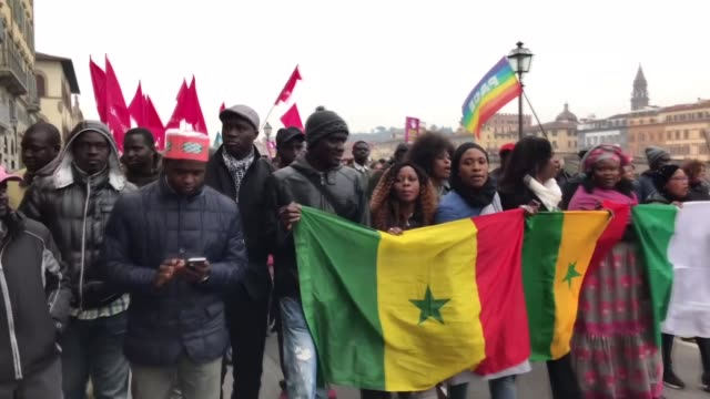 members of the senegalese community and activists march from santa maria novella square to the vespucci bridge during an antiracism protest in memory... - monumento video stock e b–roll
