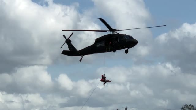 members of the south carolinahelicopter aquatic rescue team along with the south carolina army national guard with uh60 blackhawks and uh74 lakota... - helicopter stock videos & royalty-free footage