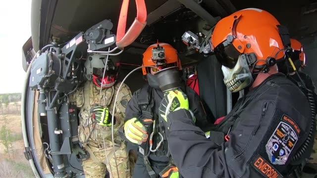 vídeos de stock e filmes b-roll de members of the south carolina-helicopter aquatic rescue team , along with the south carolina army national guard, with uh-60 blackhawks and uh-74... - baixar