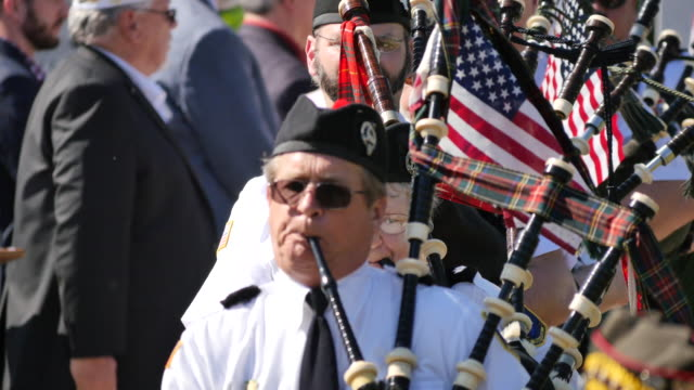 members of the southern pipe and drum corp and boy scouts from bloomington troop 148 march during memorial day ceremonies at valhalla memory gardens... - veterans of foreign wars of the united states stock videos & royalty-free footage