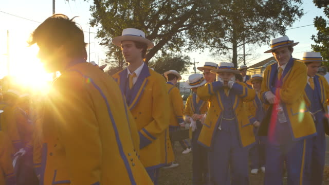 members of the sp wolves marching band stage at sunrise before the zulu parade on fat tuesday mardi gras - gras stock videos and b-roll footage