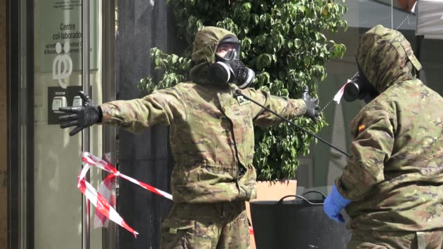 vídeos de stock e filmes b-roll de members of the spanish army, regimiento de accion nuclear biologico y quimico disinfection outside the geriatric arago retirement home during the... - army