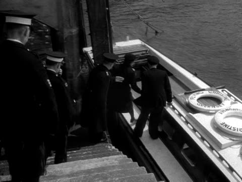 members of the st johns ambulance service board a boat ambulance moored in guernsey harbour - kanalinseln stock-videos und b-roll-filmmaterial