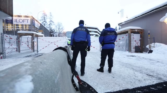 Members of the Swiss Police patrol outside the front of the Congress Center ahead of the World Economic Forum in Davos Switzerland on Tuesday Jan 19...
