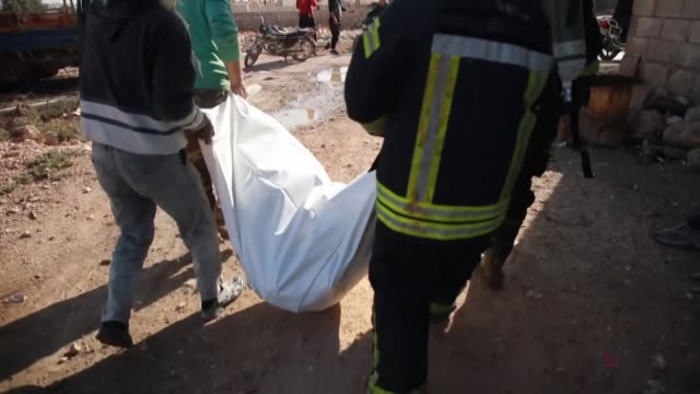 members of the syrian civil defence also known as the white helmets evacuate civilians following a reported russian air strike in the syrian village... - conflict stock videos & royalty-free footage