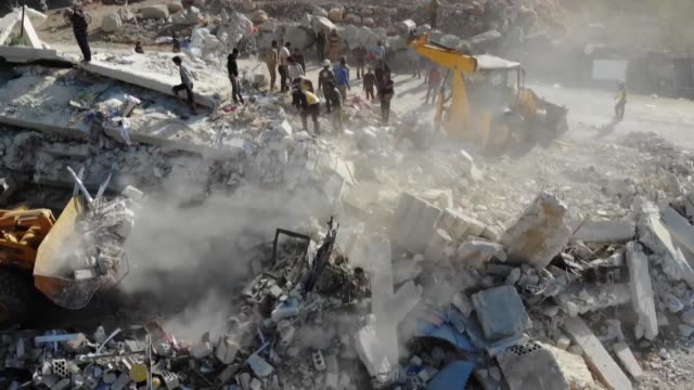 members of the syrian civil defence also known as the white helmets search for survivors after a reported airstrike by pro government forces on the... - air raid stock videos & royalty-free footage
