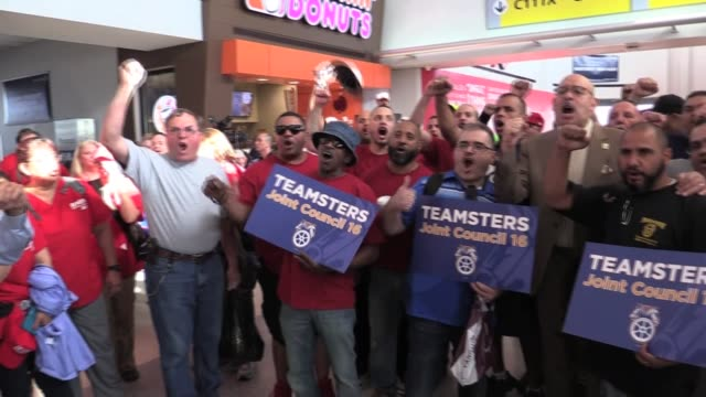 Members of the Teamsters and AFLCIO volunteers nurses doctors and volunteer pilots and crew fly on United Airlines donated plane to Puerto Rico to...