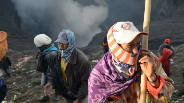 members of the tengger tribe climb mount bromo during the yadnya kasada festival in probolinggo to thrown live offerings into the crater to honour... - probolinggo stock videos & royalty-free footage
