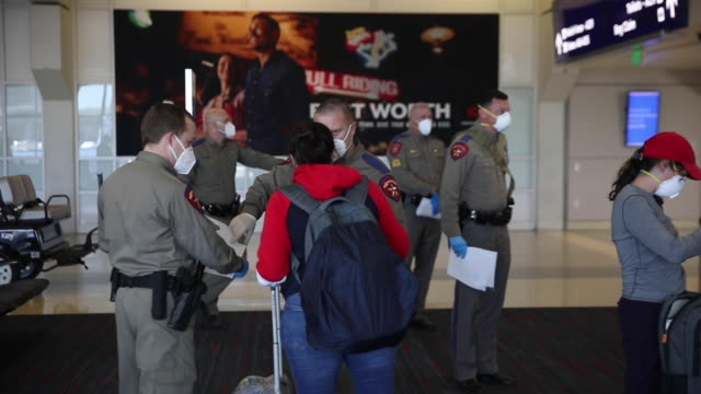 members of the texas highway patrol screen passengers arriving on a nearly full american airlines flight from san jose california to dallas fort... - dallas fort worth airport stock videos & royalty-free footage