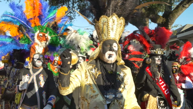 members of the the zulu social aid pleasure club dance at the intersection of jackson and claiborne at the beginning of the zulu parade on mardi gras... - gras stock videos and b-roll footage