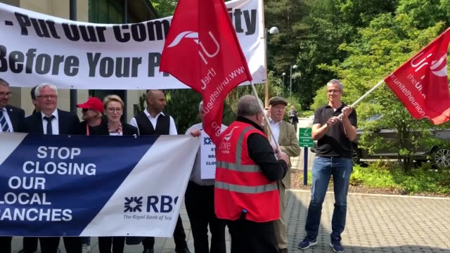 members of the unite union protest outside the the royal bank of scotland's annual general meeting being held in edinburgh, over the closure of rbs... - annual general meeting stock videos & royalty-free footage