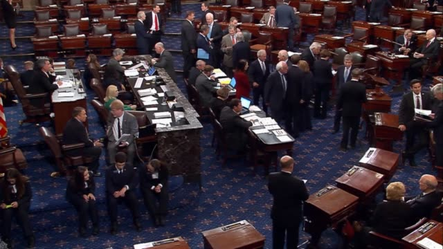 Members of the United States Senate engage in conversation while a vote closes Generic video