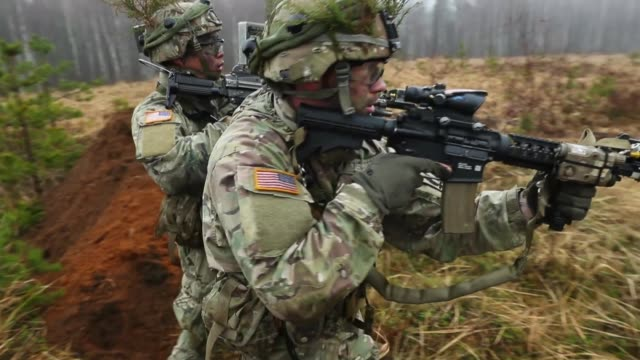 members of the us 173rd airborne brigade discuss the outcome of a simulated attack during the iron sword multinational military exercises on november... - baltic countries stock videos and b-roll footage