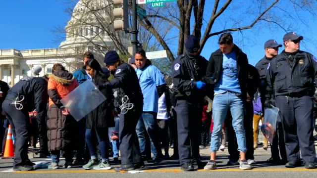 Members of the US Capitol Police arrest DACA protesters as they participate in a civil disobedience blocking an intersection on Capitol Hill during a...