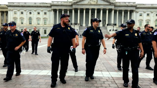 Members of the US Capitol Police clear the East Front of the US Capitol after activists participated in a civil disobedience to protest against the...