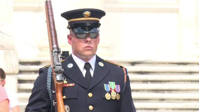 members of the us military parade in the honor guard at the tomb of the unknown at arlington national cemetery on a blazingly hot summer daythe final... - honour guard stock videos & royalty-free footage