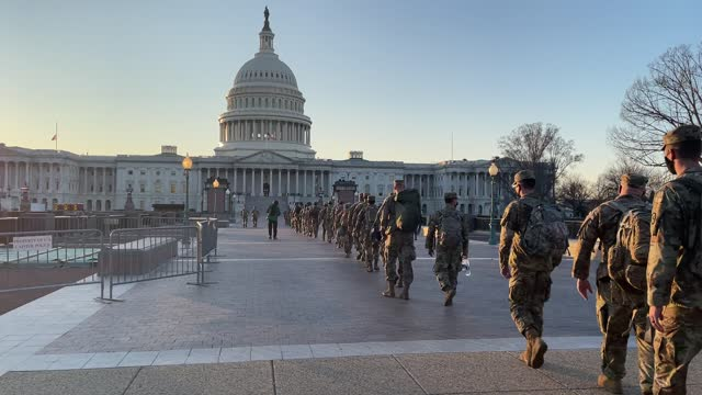 members of the u.s. national guard arrive at the u.s. capitol on january 12, 2021 in washington, dc. the pentagon is deploying as many as 15,000... - capitol building washington dc stock videos & royalty-free footage