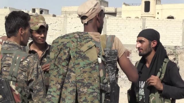 Members of the USbacked Syrian Democratic Forces inspected the damage following strikes in Raqas Nazlet Shehadeh neighbourhood Saturday
