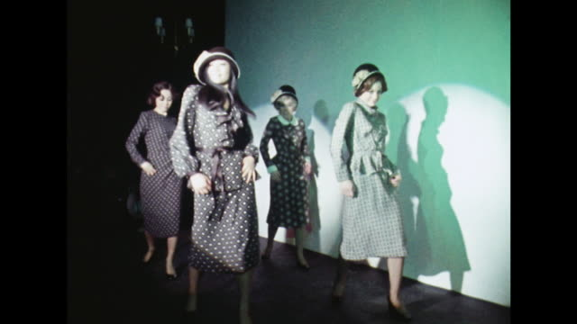 Members of the Young Generation dance troupe model clothes at a London fashion show