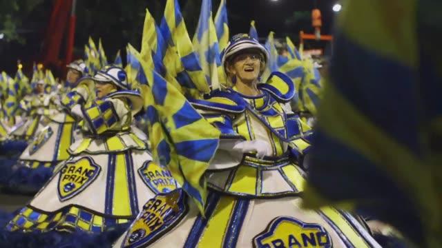 members of tijuca samba school celebrate during the 2014 brazilian carnival at sapucai sambadrome on march 04, 2014 in rio de janeiro, brazil. rio's... - brazilian culture stock videos & royalty-free footage