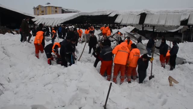 Members of Turkey's Disaster and Emergency Management Authority and firefighters engage in search and rescue operations after a roof of a local...