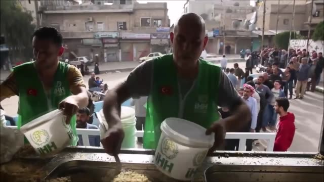 members of turkey's ihh humanitarian relief foundation distribute humanitarian aid packages to the needy people in afrin, syria on march 25, 2019.... - charity and relief work stock videos & royalty-free footage