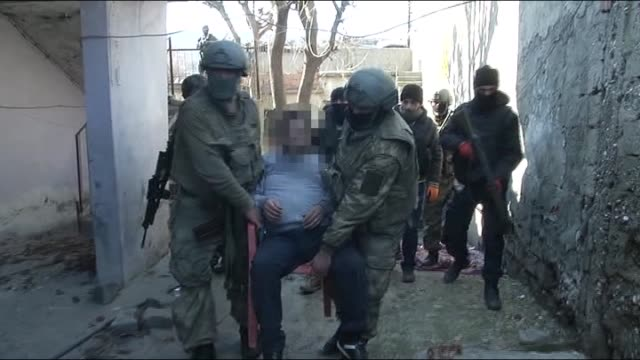 members of turkish security forces help a 5member family including a disabled man and a old woman who couldn't leave their house because of the hand... - kurdistan workers party stock videos & royalty-free footage
