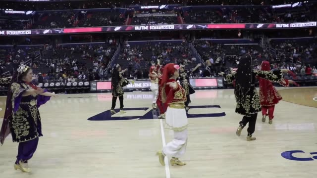 members of turkishmacedonian folklore group perform during the half time nba basketball match between washington wizards and cleveland cavaliers in... - sportliga stock-videos und b-roll-filmmaterial