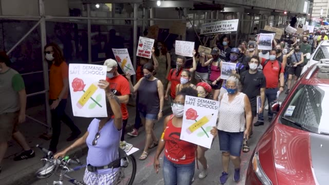 members of uft and nysut and activist, teachers, parents and students rally in front of the uft headquarters in downtown manhattan rejecting the plan... - giustizia sociale video stock e b–roll