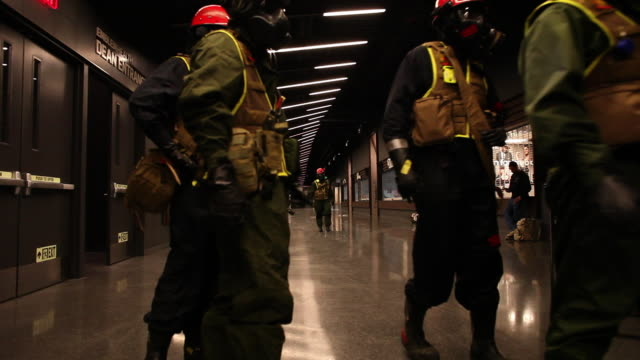 medium shot members of us marines and fdny in gas masks carry stretchers as they take part in joint drill aimed at strenghting preparedness for chemical and biological attacks at barclays center - rescue worker stock videos and b-roll footage