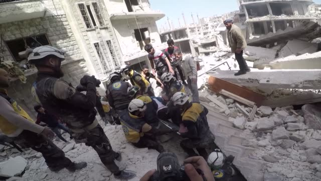 members of white helmets civil defense agency rescue a man trapped in the rubble of a building following an explosion on april 24, 2019 in jisr... - rescue worker stock videos & royalty-free footage