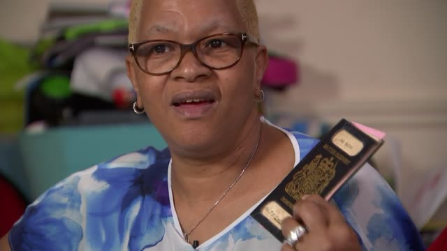 stockvideo's en b-roll-footage met members of 'windrush generation' facing threat of deportation london int joyce caesar and glenda caesar setup looking through documents and... - deportation