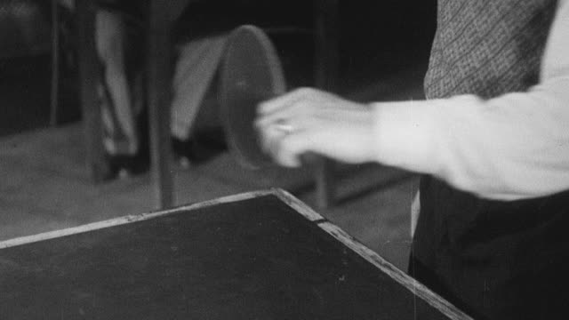 1938 montage members playing various games including darts, ping pong, and pool at a local community center / leominster, england, united kingdom - leominster stock videos and b-roll footage