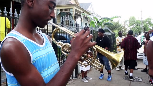 members prepare for the original big 7 social aid and pleasure club 'second line' parade on may 10, 2015 in new orleans, louisiana. traditional... - trumpet stock videos & royalty-free footage