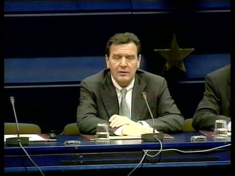 members step down; itn cms tv screen showing santer press conference people standing watching television belgium: brussels: ext gerhard schroeder off... - conference phone stock videos & royalty-free footage