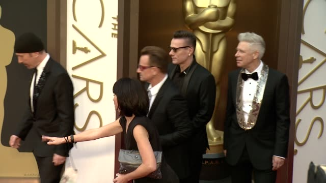 U2 members The Edge Adam Clayton Bono Larry Mullen Jr 86th Annual Academy Awards Arrivals at Hollywood Highland Center on March 02 2014 in Hollywood...
